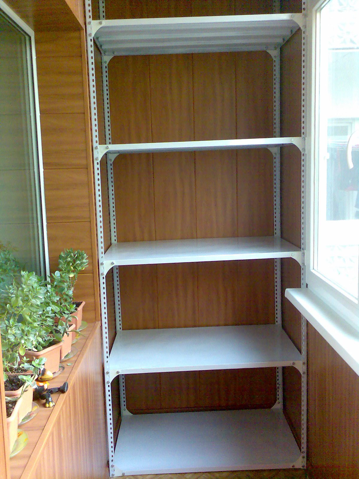 Shelving on the balcony - home decoration.