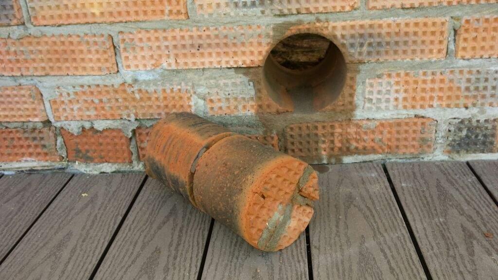 Как сделать отверстие в кирпичной стене под трубу дымохода